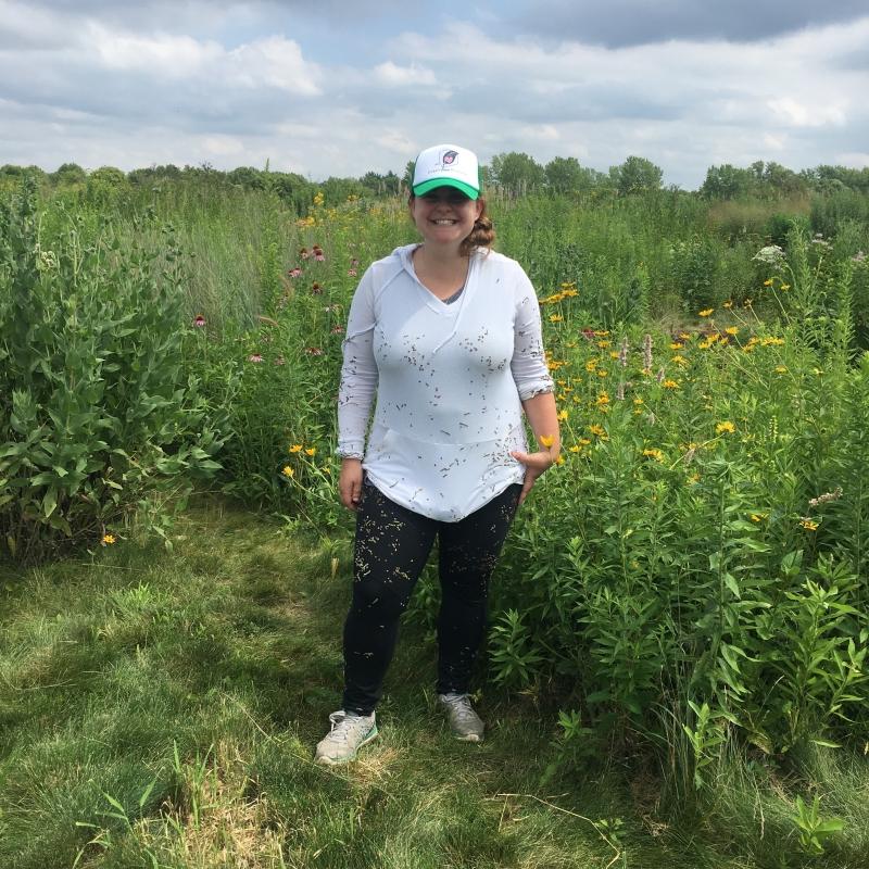Portrait of ARCS Foundation Scholar Alum Becky Barak standing in a field
