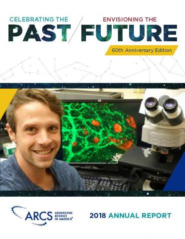 Picture of the front cover of the Annual Report Celebrating the Past, Envisioning the Future. Picture includes a smiling man in front of a workstation in a laboratory